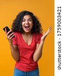 Small photo of Vertical shot of amazed girl with mobile phone in hands celebrating victory, hitting jackpot in lottery, making bets online at bookmaker's website. Female blogger happy to get one mil