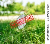 Small photo of Plastic bags banned in Germany. Used plastic bag dumped on the green grass. Red stamp over the bag with word Banned, Verboten. Environmental pollution concept. Verboten - banned, forbidden.