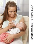 young mother feeding baby girl... | Shutterstock . vector #175911614
