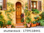 Small photo of Old Italy street house entrance. Arched door in Italy town