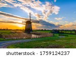 Sunset windmill farm in holland....