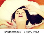 Stock photo face closeup of a pleased beautiful woman during morning sex in bed 175977965