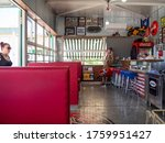 Greece, June 2020: a Counter with an American flag, bar stools, a cowboy mannequin and biker attributes at an American-style biker bar in Greece - stock photo