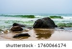 Rocks And Waves On The Beach...