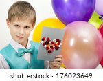beautiful child with balloons... | Shutterstock . vector #176023649