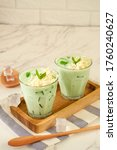Small photo of Buko pandan. Dessert from philippines. Made from jelly, young coconut, evaporated milk, sweetened condensed milk, ice cubes and cheese tropping and pandanus leaves as garnish.