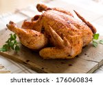 whole roasted chicken on wooden ... | Shutterstock . vector #176060834