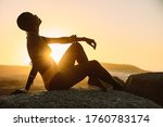 Silhouette Of A Woman Sitting...