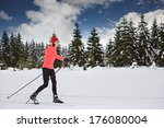 a woman cross country skiing in ...   Shutterstock . vector #176080004