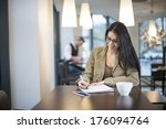 smart woman writing in a cafe | Shutterstock . vector #176094764