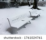 Snow Covered Bench In The Park...