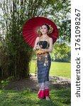 Asian Beautiful Woman Dressed...