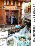 Small photo of February 2019. Shaxi. Daily life scenes. Halfway between Dali and Lijiang, between the fields and mountains of Yunnan, a stop in the village of Shaxi is like taking a magnificent journey through time