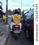 Small photo of Bantul, 22 June 2020. Pillion riders in yellow jackets in Bantul, Yogyakarta, Indonesia