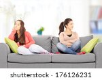 Two Teenage Girls Sitting On...