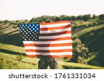 American soldier with usa flag on his back looks into the distance. United States Army. Veterans Day