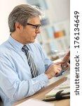 senior businessman in office... | Shutterstock . vector #176134649