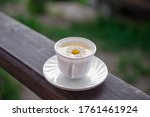 Reen Tea In A White Mug With A...