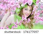 beautiful girl in a flowered... | Shutterstock . vector #176177057