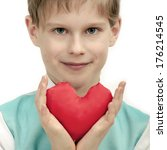 smiling boy with red heart in... | Shutterstock . vector #176214545