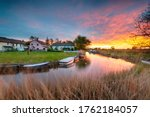Small photo of Stunning sunset over the village green and boats on the river at West Somerton in the Norfolk Broads
