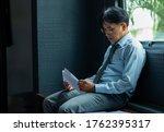 Stressed Asian Businessman...
