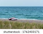 Two Singke Kayak On Shore Of...