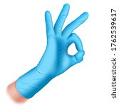 hand in a rubber glove of blue... | Shutterstock .eps vector #1762539617