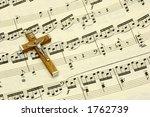 crucifix on top of sheet music | Shutterstock . vector #1762739
