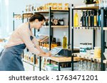 Saleswoman Selling Products In...