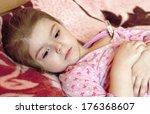 sick little girl in bed.... | Shutterstock . vector #176368607