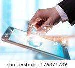 hand touching digital tablet ... | Shutterstock . vector #176371739
