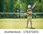 little cute boy playing tennis... | Shutterstock . vector #176372651