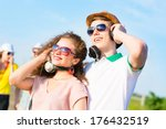 young couple standing on the... | Shutterstock . vector #176432519