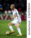 Small photo of Berlin, GERMANY - July 09, 2006: Zinedine Zidane in action during the 2006 FIFA World Cup Germany Final Italy v France at the Olympiastadion.