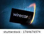 Small photo of Madrid, Spain - June 27, 2020: Wirecard prepaid card burning on fire following the company bankruptcy and the freezing of cardholders' money, financial collapse