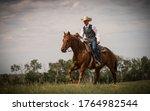 Cowboy Riding Across The...