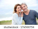 cheerful middle aged couple on... | Shutterstock . vector #176500754