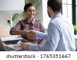 Small photo of Recruiter shaking successful smiling Indian businesswoman candidate hand at meeting, congratulating with getting new job, manager making great deal with customer, diverse business partners greeting