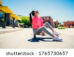 Small photo of Attractive female teenager in stylish sunglasses resting at longboard during sport hobby in city, young Asian woman dressed in trendy girlish streetwear enjoying recreation chill at skateboard