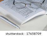book glasses and pencil on an... | Shutterstock . vector #17658709