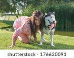 girl and her faithful husky   Shutterstock . vector #176620091