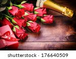 Stock photo valentine s setting with red roses and present 176640509