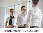 happy business people shaking... | Shutterstock . vector #176658989