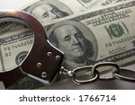 Close Up Handcuffs And Money