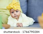 Portrait Of Cute Baby Girl Wit...