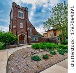Small photo of GRAND LEDGE, MI - June 21: Exterior view of Trinity Episcopal church in Grand Ledge, MI on June 21, 2020