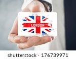 british businessman holding... | Shutterstock . vector #176739971