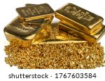A pile of gold bars and gold granules isolated on white background. Selective focus. - stock photo