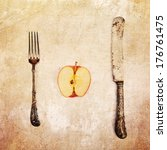 picture of an apple half with antique cutlery processed with a vintage style texture - stock photo